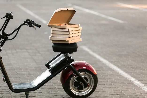 Pizza boxes on delivery motorcycle Free Photo