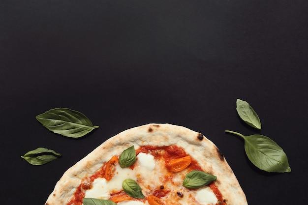 Pizza on dark Free Photo
