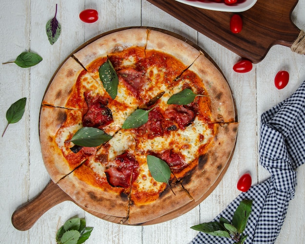 Pizza margarita on the table Free Photo