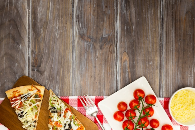 Pizza slices with tomatoes Free Photo
