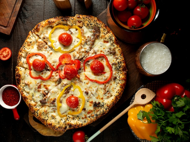 Pizza with meat and vegetables Free Photo