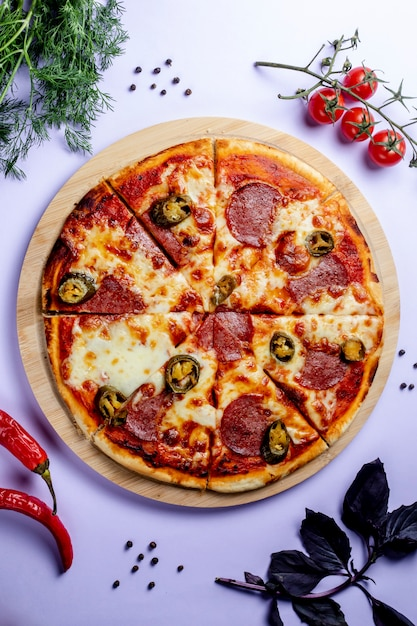 Pizza with side vegetables and herbs Free Photo