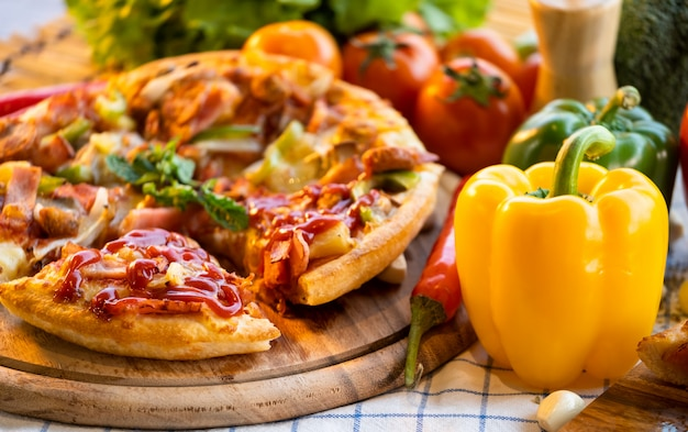 Pizza with tomatoes and sweet chilli. Premium Photo