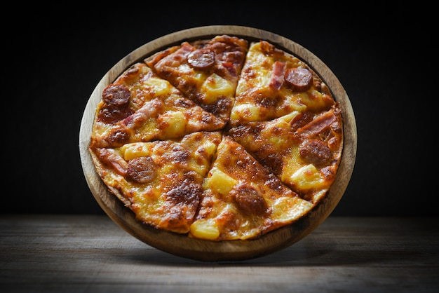Pizza on wooden plate Premium Photo