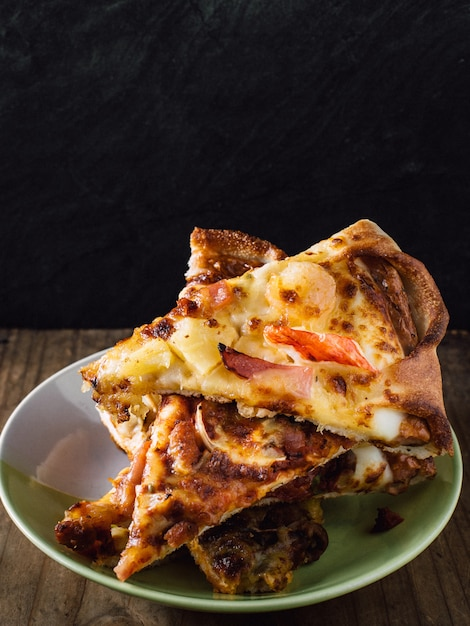 Pizza on wooden table Premium Photo