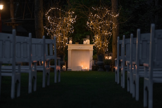 Place for wedding altar made of cosy fireplace and candles Free Photo