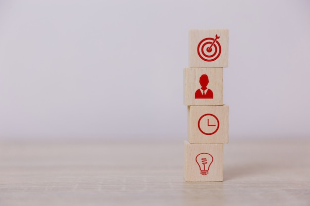 Place wooden blocks service concept of business to success business strategy planning to market victory. Premium Photo
