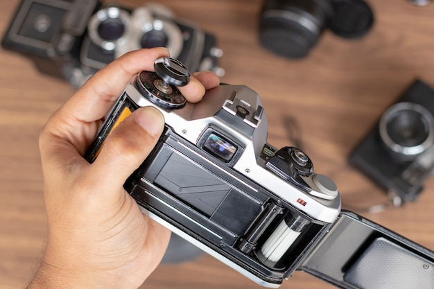Placing photographic roll in a camera Premium Photo