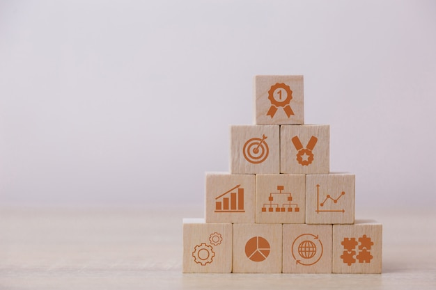 Placing wooden blocks on the concept of permit service for the success of business strategy planning Premium Photo