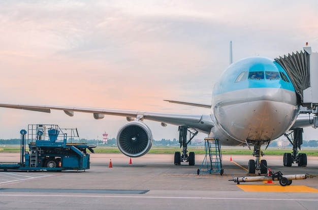 The plane at the airport on loading Premium Photo