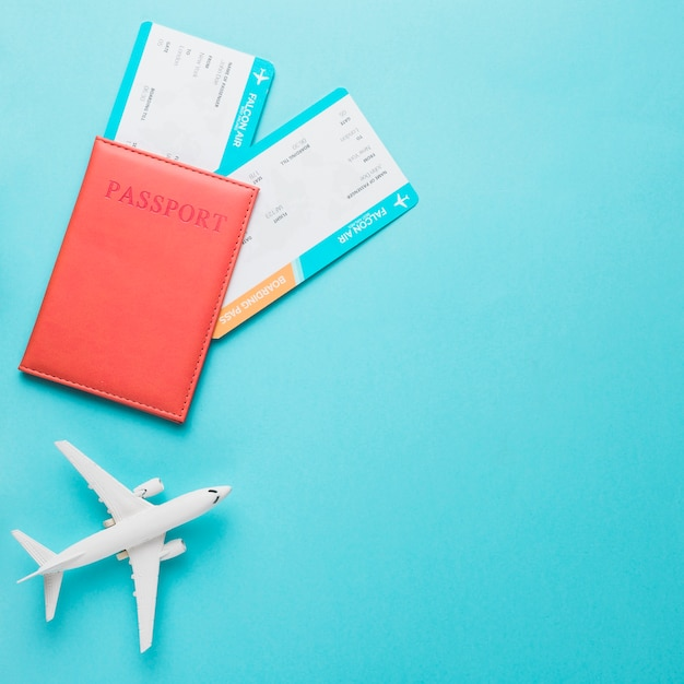 Plane passport and boarding pass for travel Free Photo