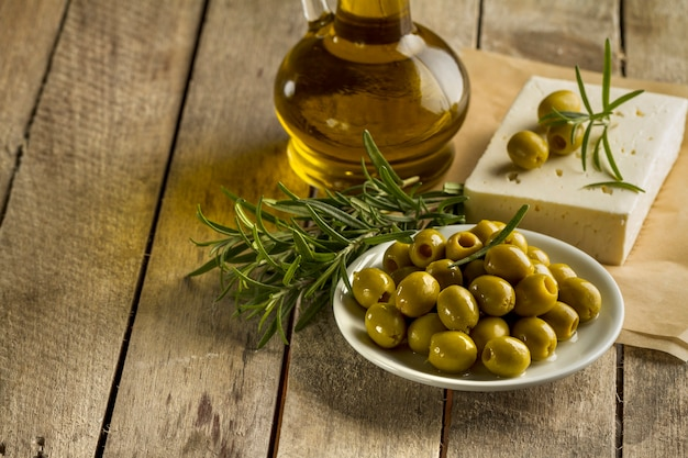 Planks with olives and olive oil Free Photo