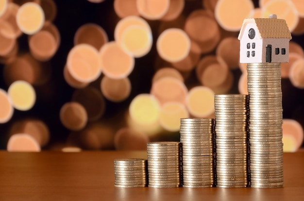 Planning savings money of coins to buy a home concept Premium Photo