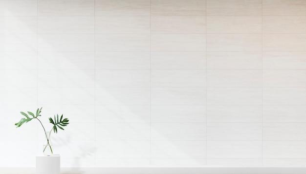 Завод на фоне белой стены макет Бесплатные Фотографии