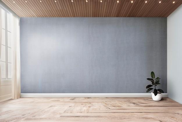 Завод в пустой комнате с серым макетом стены Бесплатные Фотографии