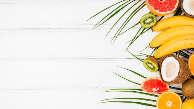 Plant leaves with fresh tropical fruits Free Photo