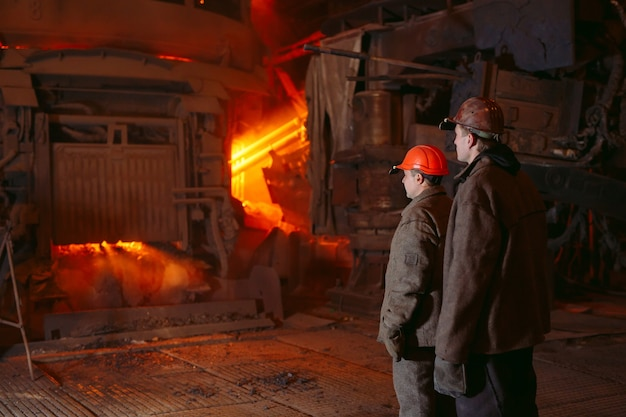 Plant for the production of steel an electric melting furnace. worker portrait. Premium Photo