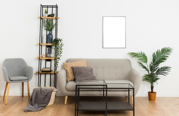 Plants with empty frame and sofa Free Photo
