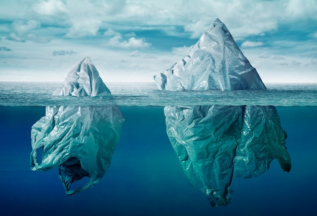 Plastic bag environment pollution with iceberg of trash Premium Photo