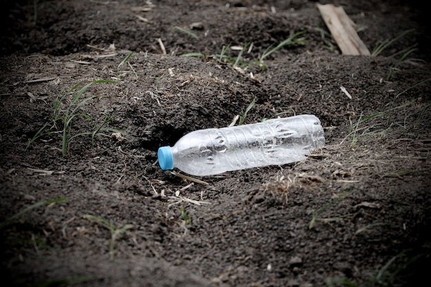 Plastic bottle garbage on the soil ground  that can recycle Premium Photo