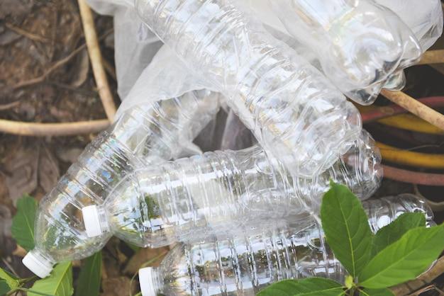 Plastic bottle pollution environment / recycle waste management Premium Photo