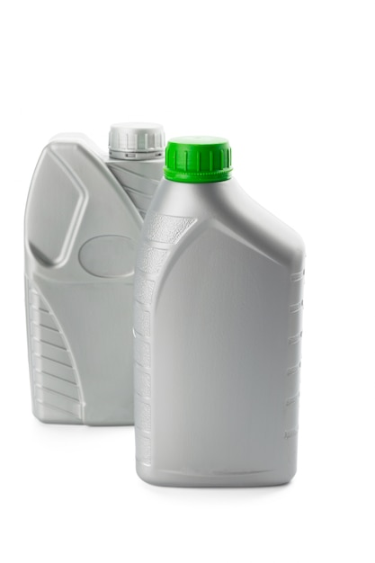 Plastic bottles from automobile oils isolated on white Premium Photo