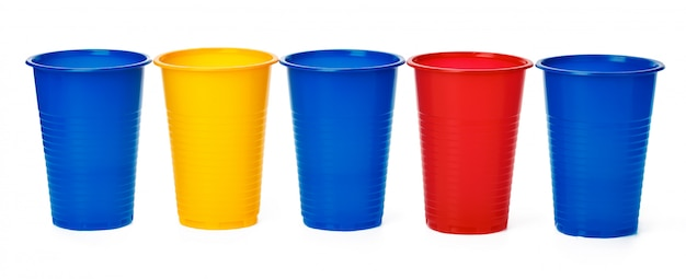 Plastic cups on white background Premium Photo
