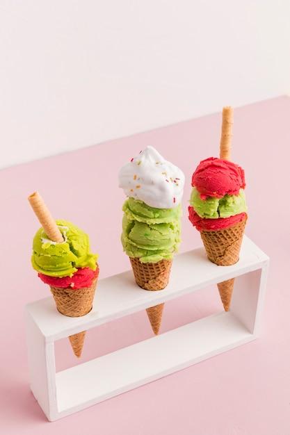 Plastic holder with colorful ice cream cones Free Photo
