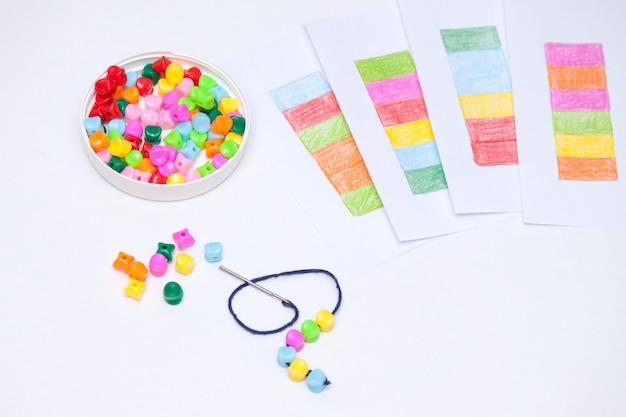 Plastic multicolored beads. homemade game for children development concept. Premium Photo