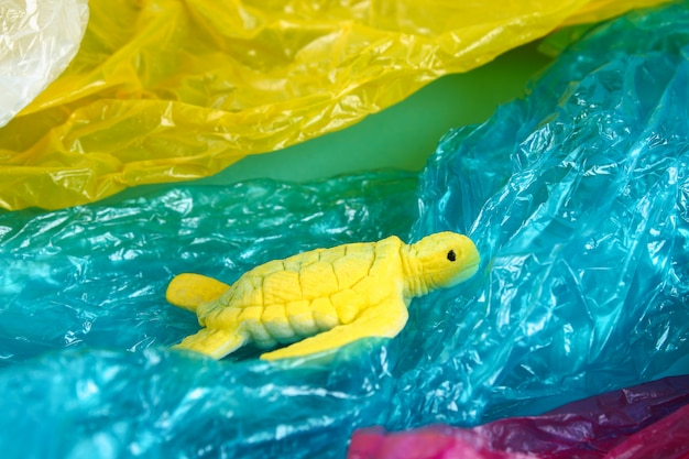 Plastic pollution in ocean problem. sea turtle plastic bag. ecological situation. zero waste Premium Photo