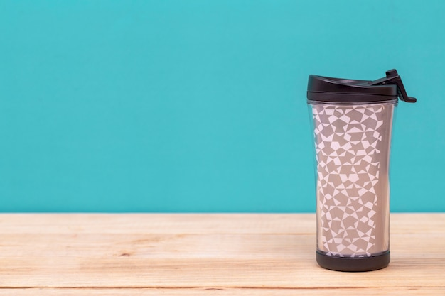 Plastic tumbler glasses or thermos travel cup Premium Photo