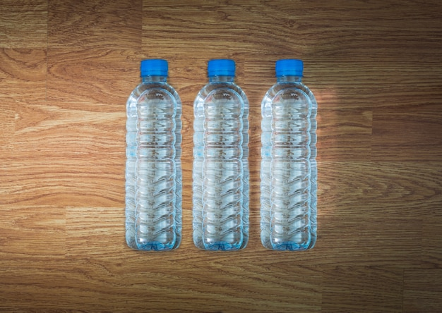 Plastic water bottle on the wooden table Premium Photo