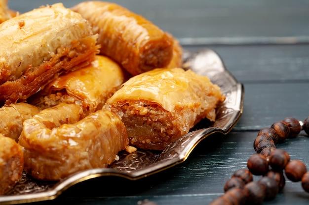 Plate of baklava dessert close up served on table Premium Photo