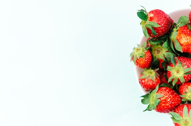Plate of bright ripe strawberry fruit Free Photo
