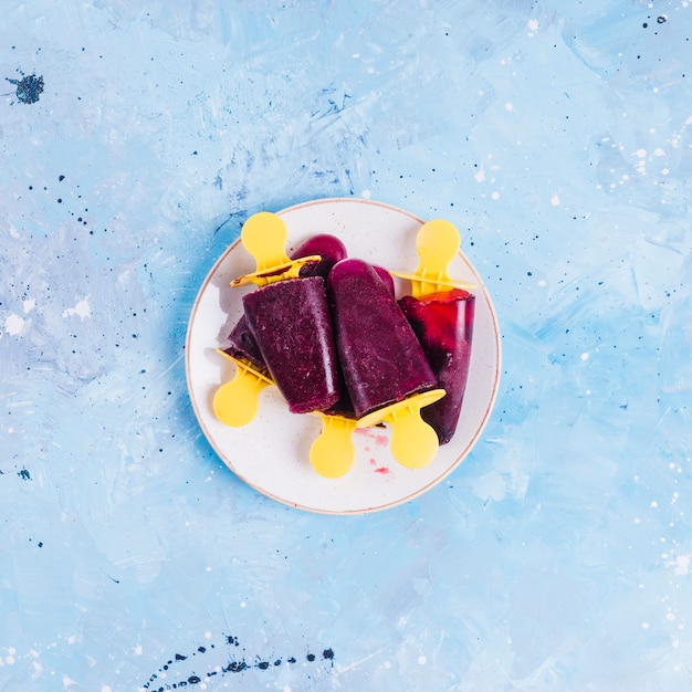 Plate of dark red popsicles Free Photo