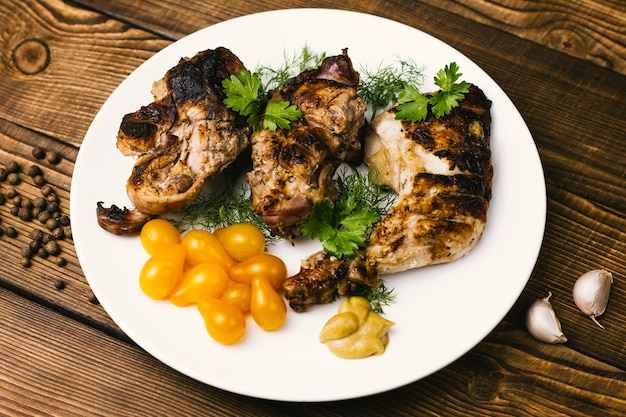 Plate of grilled meat and tomatoes Free Photo