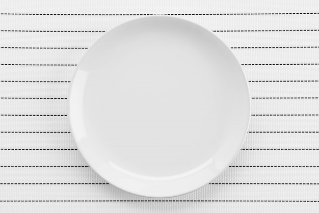 Plate mat with plate fork and knife Free Photo