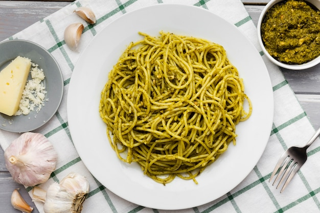 Plate of pasta with garlic and cheese Free Photo
