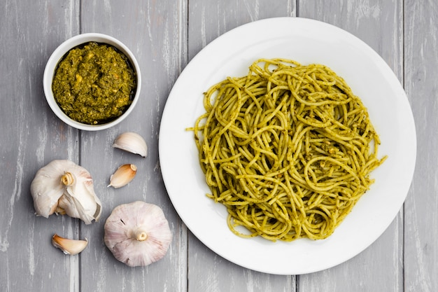 Plate of pasta with garlic and sauce Free Photo
