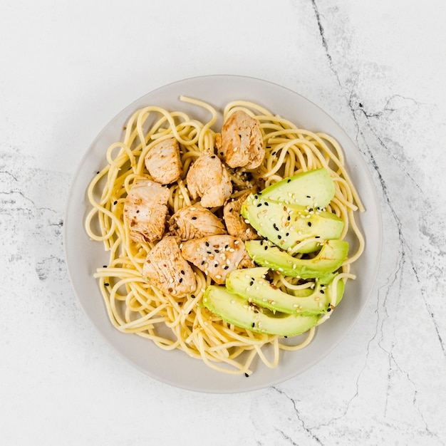 Plate of pasta with meat and avocado Free Photo