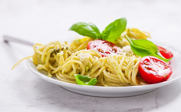 Plate of spaghetti with tomatoes and cheese Free Photo