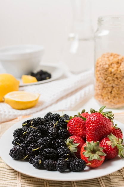 Plate of strawberries and mulberries Free Photo