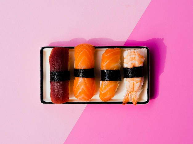 Plate of sushi variaton on a rose background Free Photo