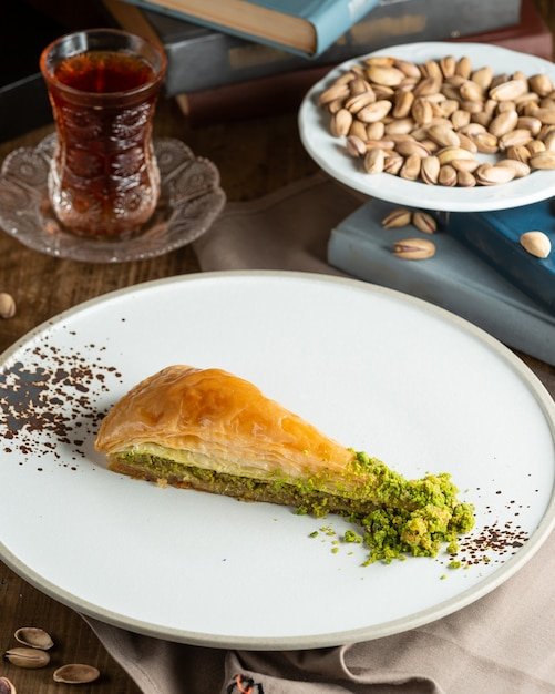 A plate of turkish pakhlava with pistachio Free Photo
