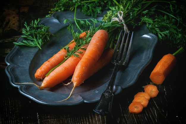 Plate with fresh carrots Premium Photo