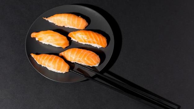 Plate with fresh variety of sushi Premium Photo
