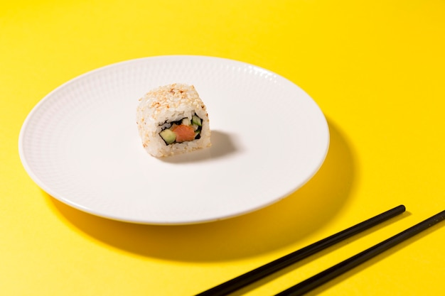Plate with one sushi roll Free Photo