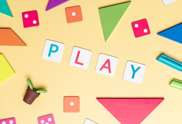 Play with toy and objects for child education concept on yellow Premium Photo