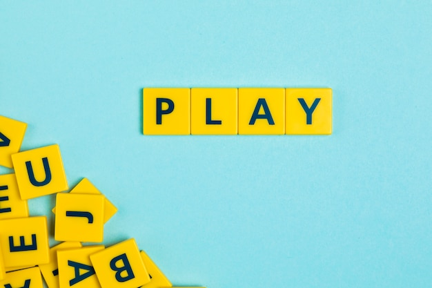Play word on scrabble tiles Free Photo