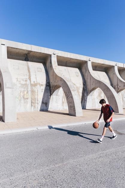 Player playing basketball near surrounding wall Free Photo